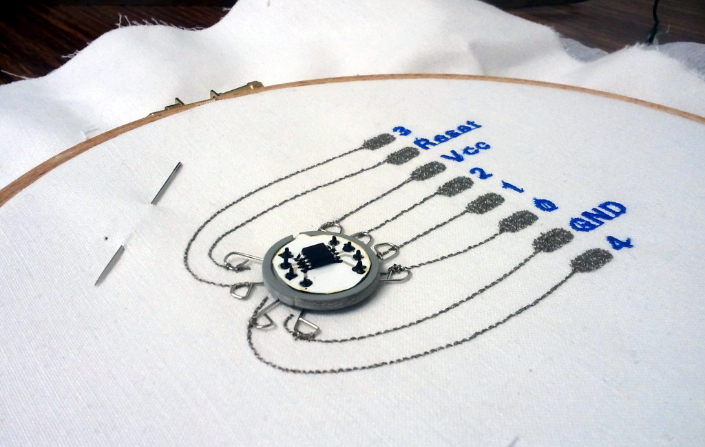 Button on sewn circuit